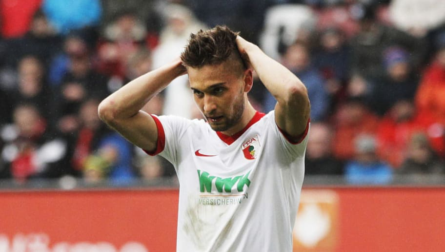 AUGSBURG, GERMANY - MARCH 18:  Moritz Leitner of Augsburg is dejected during the Bundesliga match between FC Augsburg and SC Freiburg at WWK Arena on March 18, 2017 in Augsburg, Germany.  (Photo by Adam Pretty/Bongarts/Getty Images)