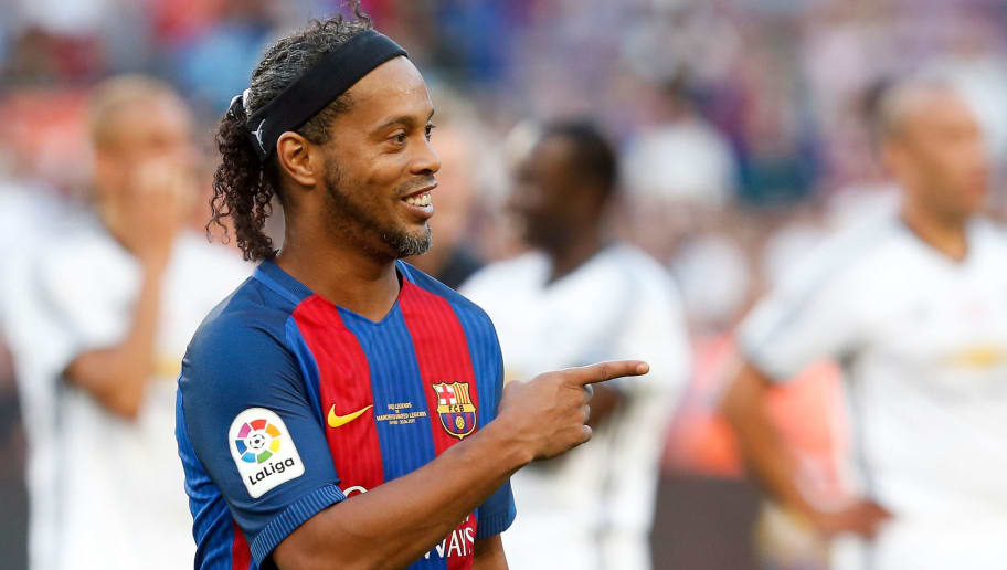Former Barcelona's Brazilian forward Ronaldinho points his finger after a charity football match between Barcelona Legends vs Manchester United Legends at the Camp Nou stadium in Barcelona on June 30, 2017. / AFP PHOTO / Pau Barrena        (Photo credit should read PAU BARRENA/AFP/Getty Images)