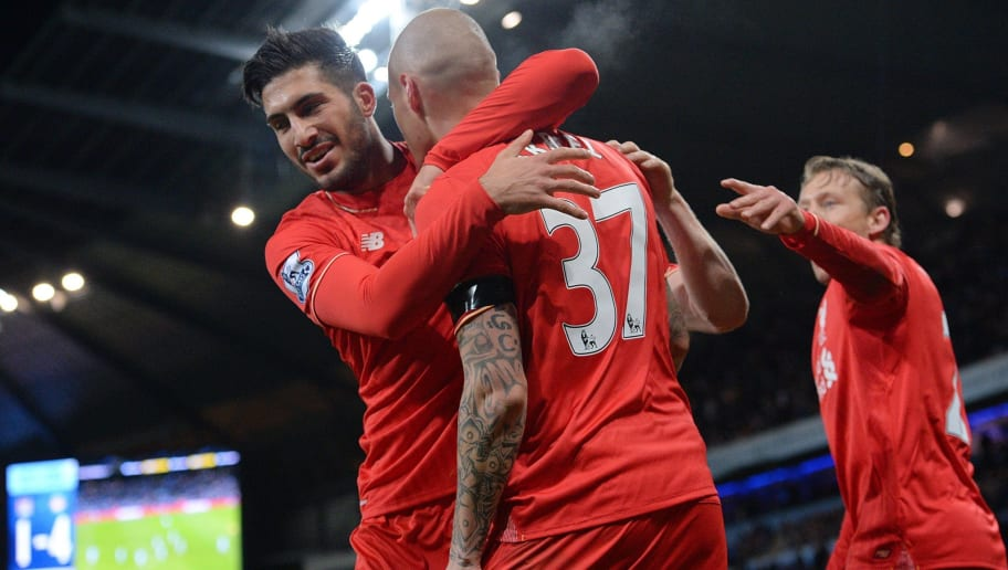 Liverpool's Slovakian defender Martin Skrtel (2nd R) celebrates with Liverpool's German midfielder Emre Can after scoring their fourth goal of the English Premier League football match between Manchester City and Liverpool at The Etihad stadium in Manchester, north west England on November 21, 2015. Liverpool won the game 4-1. AFP PHOTO / OLI SCARFF  RESTRICTED TO EDITORIAL USE. No use with unauthorized audio, video, data, fixture lists, club/league logos or 'live' services. Online in-match use limited to 75 images, no video emulation. No use in betting, games or single club/league/player publications.        (Photo credit should read OLI SCARFF/AFP/Getty Images)
