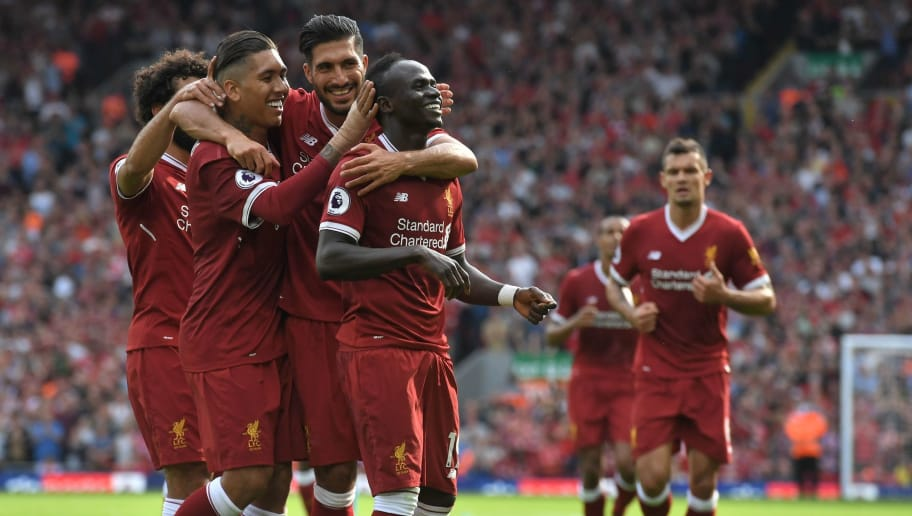 Liverpool's Senegalese midfielder Sadio Mane (centre right) celebrates with teammates after scoring their second goal during the English Premier League football match between Liverpool and Arsenal at Anfield in Liverpool, north west England on August 27, 2017. / AFP PHOTO / Anthony Devlin / RESTRICTED TO EDITORIAL USE. No use with unauthorized audio, video, data, fixture lists, club/league logos or 'live' services. Online in-match use limited to 75 images, no video emulation. No use in betting, games or single club/league/player publications.  /         (Photo credit should read ANTHONY DEVLIN/AFP/Getty Images)