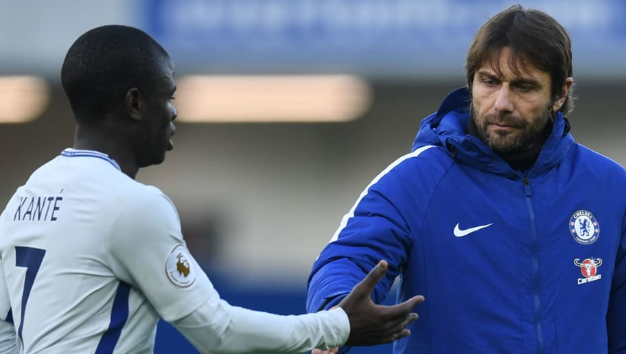 Chelsea's Italian head coach Antonio Conte (R) gestures to Chelsea's French midfielder N'Golo Kante on the pitch after the English Premier League football match between Everton and Chelsea at Goodison Park in Liverpool, north west England on December 23, 2017. The game finished 0-0. / AFP PHOTO / PAUL ELLIS / RESTRICTED TO EDITORIAL USE. No use with unauthorized audio, video, data, fixture lists, club/league logos or 'live' services. Online in-match use limited to 75 images, no video emulation. No use in betting, games or single club/league/player publications.  /         (Photo credit should read PAUL ELLIS/AFP/Getty Images)
