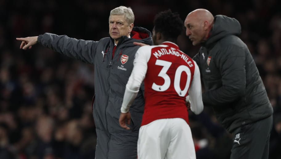 Arsenal's French manager Arsene Wenger (L) instructs Arsenal's English midfielder Ainsley Maitland-Niles during the English Premier League football match between Arsenal and Liverpool at the Emirates Stadium in London on December 22, 2017.  / AFP PHOTO / Adrian DENNIS / RESTRICTED TO EDITORIAL USE. No use with unauthorized audio, video, data, fixture lists, club/league logos or 'live' services. Online in-match use limited to 75 images, no video emulation. No use in betting, games or single club/league/player publications.  /         (Photo credit should read ADRIAN DENNIS/AFP/Getty Images)