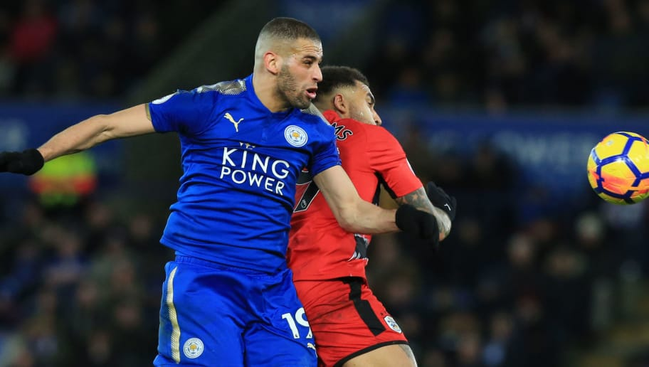 Leicester City's Algerian striker Islam Slimani (L) vie Huddersfield Town's German-born US midfielder Danny Williams during the English Premier League football match between Leicester City and Huddersfield Town at King Power Stadium in Leicester, central England on January 1, 2018. / AFP PHOTO / Lindsey PARNABY / RESTRICTED TO EDITORIAL USE. No use with unauthorized audio, video, data, fixture lists, club/league logos or 'live' services. Online in-match use limited to 75 images, no video emulation. No use in betting, games or single club/league/player publications.  /         (Photo credit should read LINDSEY PARNABY/AFP/Getty Images)