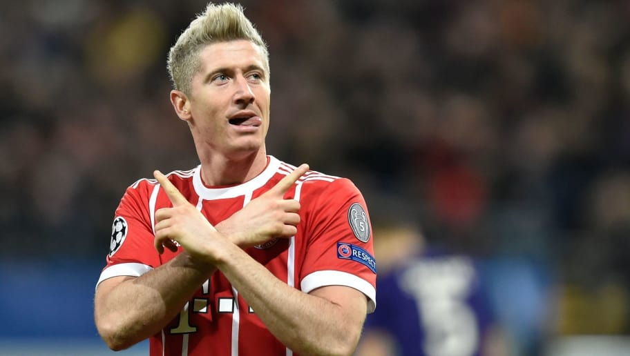 Bayern Munich's Polish forward Robert Lewandowski celebrates after scoring a goal during the UEFA Champions League Group B football match between Anderlecht and Bayern Munich at Constant Vanden Stock Stadium in Brussels on November 22, 2017.  / AFP PHOTO / JOHN THYS        (Photo credit should read JOHN THYS/AFP/Getty Images)