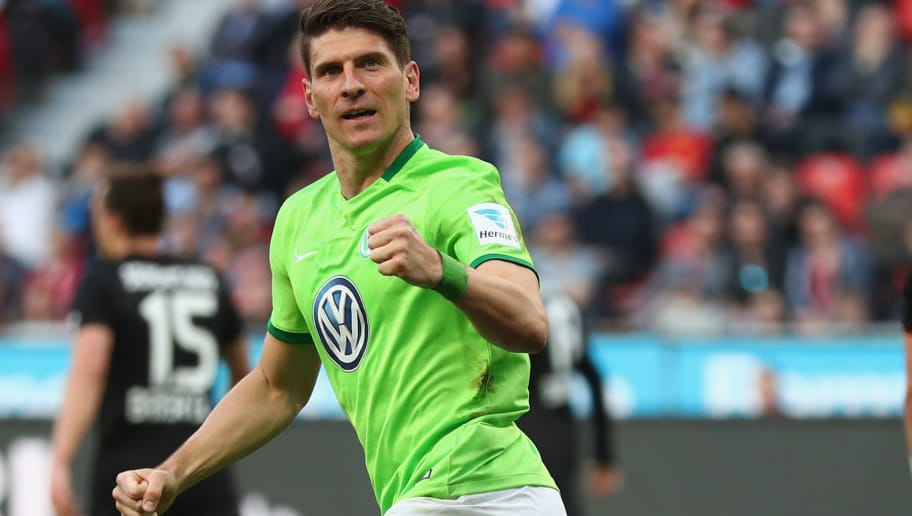 LEVERKUSEN, GERMANY - APRIL 02:  Mario Gomez of Wolfsburg celebrates scoring his first goal during the Bundesliga match between Bayer 04 Leverkusen and VfL Wolfsburg at BayArena on April 2, 2017 in Leverkusen, Germany.  (Photo by Lars Baron/Bongarts/Getty Images)