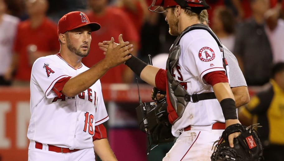 ANAHEIM, CA - JULY 19:  Huston Street #16 is congratulated by Jett Bandy #47 of the Los Angeles Angels of Anaheim after defeating the Texas Rangers 8-6 in a baseball game at Angel Stadium of Anaheim on July 19, 2016 in Anaheim, California.  (Photo by Sean M. Haffey/Getty Images)