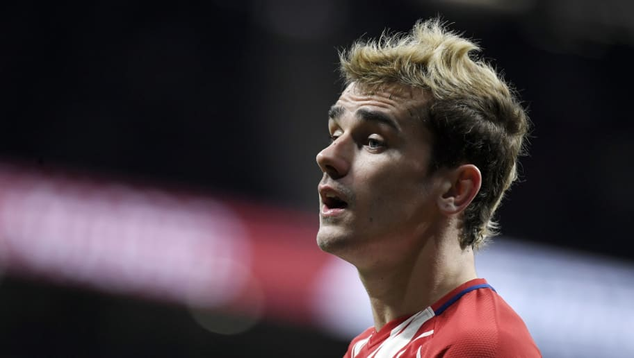 Atletico Madrid's French forward Antoine Griezmann looks on during the Spanish league football match Club Atletico de Madrid against Alaves at the Wanda Metropolitano stadium in Madrid on December 16, 2017. / AFP PHOTO / GABRIEL BOUYS        (Photo credit should read GABRIEL BOUYS/AFP/Getty Images)