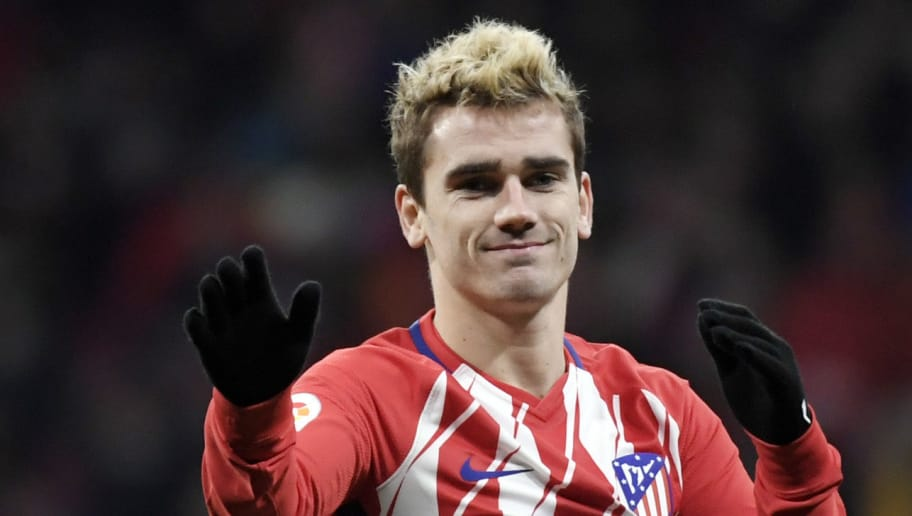 Atletico Madrid's French forward Antoine Griezmann gestures during the Spanish league football match Club Atletico de Madrid against Alaves at the Wanda Metropolitano stadium in Madrid on December 16, 2017. / AFP PHOTO / GABRIEL BOUYS        (Photo credit should read GABRIEL BOUYS/AFP/Getty Images)