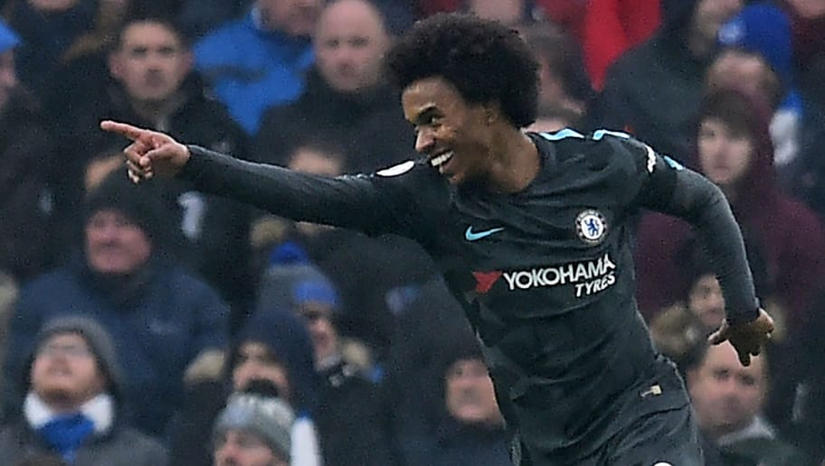 Chelsea's Brazilian midfielder Willian celebrates after scoring their second goal during the English Premier League football match between Brighton and Hove Albion and Chelsea at the American Express Community Stadium in Brighton, southern England on January 20, 2018. / AFP PHOTO / Glyn KIRK / RESTRICTED TO EDITORIAL USE. No use with unauthorized audio, video, data, fixture lists, club/league logos or 'live' services. Online in-match use limited to 75 images, no video emulation. No use in betting, games or single club/league/player publications.  /         (Photo credit should read GLYN KIRK/AFP/Getty Images)