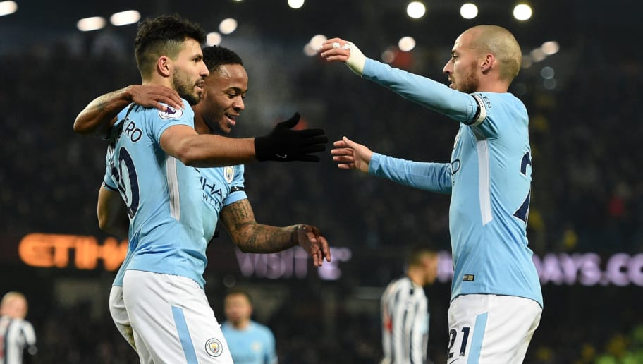 Manchester City's Argentinian striker Sergio Aguero (L) celebrates with teammates after scoring their second goal from the penalty spot during the English Premier League football match between Manchester City and Newcastle United at the Etihad Stadium in Manchester, north west England, on January 20, 2018. / AFP PHOTO / Oli SCARFF / RESTRICTED TO EDITORIAL USE. No use with unauthorized audio, video, data, fixture lists, club/league logos or 'live' services. Online in-match use limited to 75 images, no video emulation. No use in betting, games or single club/league/player publications.  /         (Photo credit should read OLI SCARFF/AFP/Getty Images)