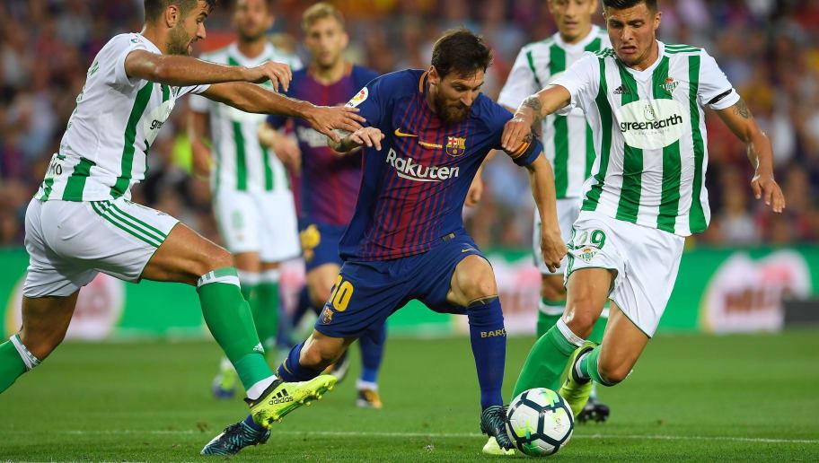 Barcelonas Argentinian Forward Lionel Messi C Vies With Betis Forward Alex Alegria