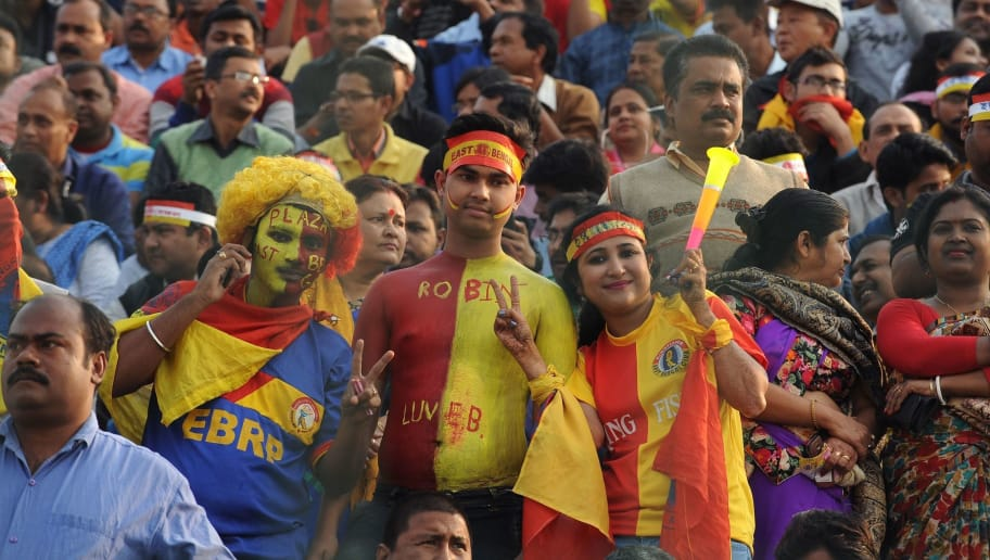 East Bengal supporters cheer their team during an Indian I-League football match between Mohun Bagan and East Bengal at the Kanchenjungha Stadium in Siliguri on February 12, 2017. The anticipated derby match ended with a drawless 0-0 result. / AFP / DIPTENDU DUTTA        (Photo credit should read DIPTENDU DUTTA/AFP/Getty Images)
