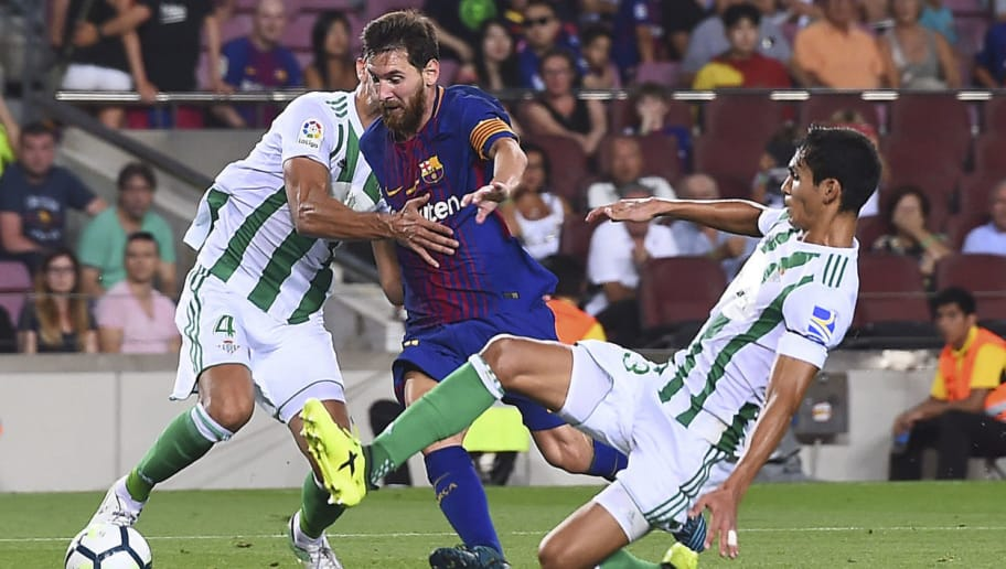 Barcelona's Argentinian forward Lionel Messi (L) vies with Betis' Algerian defender Aissa Mandi during the Spanish league footbal match FC Barcelona vs Real Betis at the Camp Nou stadium in Barcelona on August 20, 2017. / AFP PHOTO / Josep LAGO        (Photo credit should read JOSEP LAGO/AFP/Getty Images)
