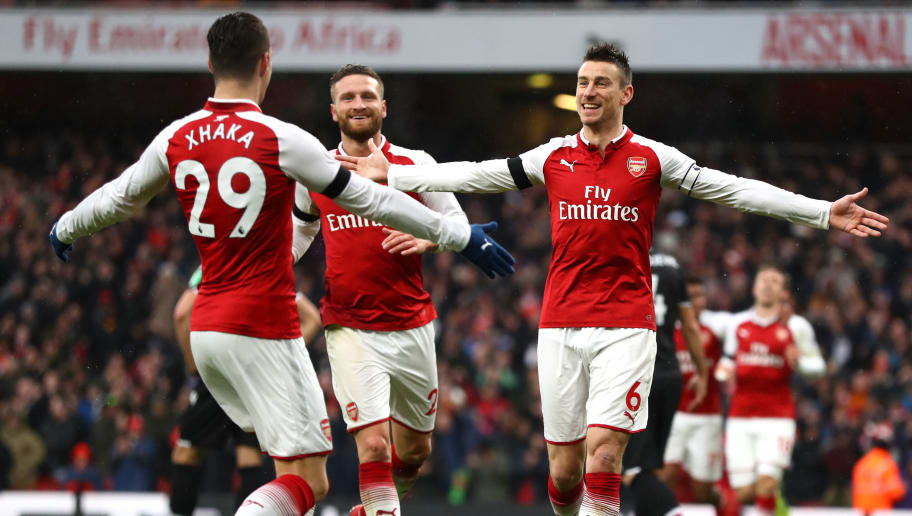 LONDON, ENGLAND - JANUARY 20: Laurent Koscielny of Arsenal celebrates after scoring his sides third goal with Granit Xhaka of Arsenal during the Premier League match between Arsenal and Crystal Palace at Emirates Stadium on January 20, 2018 in London, England.  (Photo by Clive Mason/Getty Images)