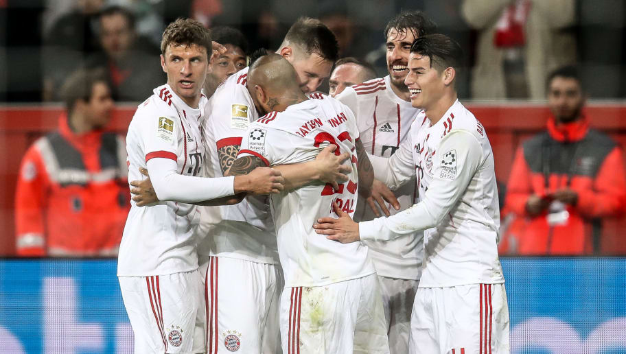 LEVERKUSEN, GERMANY - JANUARY 12: Javi Martinez of Bayern Muenchen (2R) celebrates with team mates as he scores their first goal during the Bundesliga match between Bayer 04 Leverkusen and FC Bayern Muenchen at BayArena on January 12, 2018 in Leverkusen, Germany. (Photo by Maja Hitij/Bongarts/Getty Images)