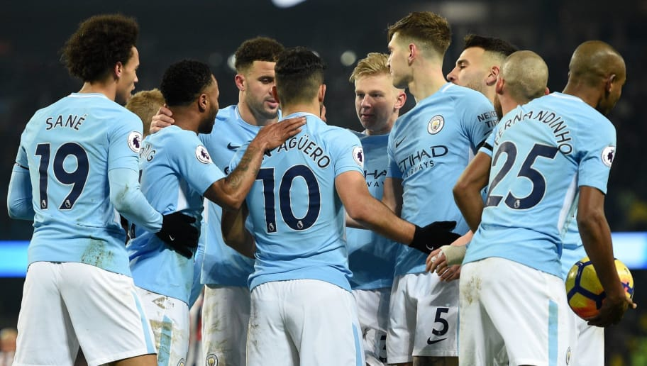 Manchester City's Argentinian striker Sergio Aguero (C) celebrates with teammates after scoring their second goal from the penalty spot during the English Premier League football match between Manchester City and Newcastle United at the Etihad Stadium in Manchester, north west England, on January 20, 2018. Manchester City won the game 3-1. / AFP PHOTO / Oli SCARFF / RESTRICTED TO EDITORIAL USE. No use with unauthorized audio, video, data, fixture lists, club/league logos or 'live' services. Online in-match use limited to 75 images, no video emulation. No use in betting, games or single club/league/player publications.  /         (Photo credit should read OLI SCARFF/AFP/Getty Images)