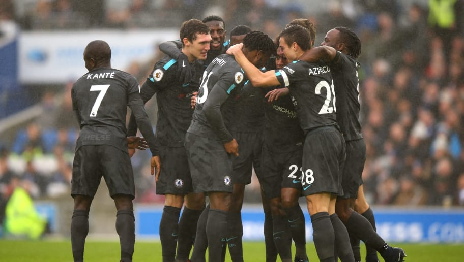 BRIGHTON, ENGLAND - JANUARY 20:  Willian of Chelsea (22) celebrates as he scores their second goal with team mates during the Premier League match between Brighton and Hove Albion and Chelsea at Amex Stadium on January 20, 2018 in Brighton, England.  (Photo by Bryn Lennon/Getty Images)