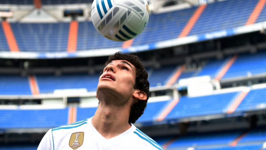 Real Madrid's new player Jesus Vallejo plays with a ball after his official presentation at the Santiago Bernabeu stadium in Madrid, on July 7, 2017. / AFP PHOTO / JAVIER SORIANO        (Photo credit should read JAVIER SORIANO/AFP/Getty Images)