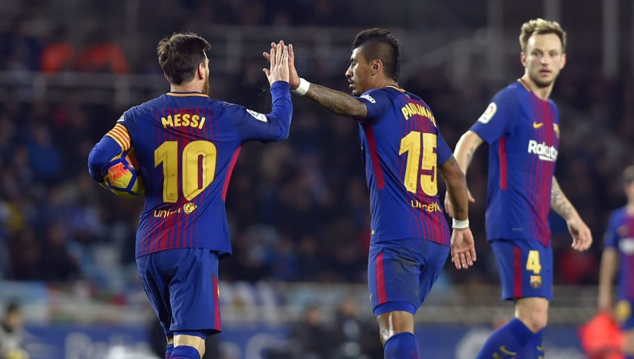 Barcelona's Brazilian midfielder Paulinho (C) is congratulated by teammate Argentinian forward Lionel Messi (L) beside Barcelona's Croatian midfielder Ivan Rakitic after scoring his team's first goal during the Spanish league football match between Real Sociedad and FC Barcelona at the Anoeta stadium in San Sebastian on January 14, 2018. / AFP PHOTO / ANDER GILLENEA        (Photo credit should read ANDER GILLENEA/AFP/Getty Images)