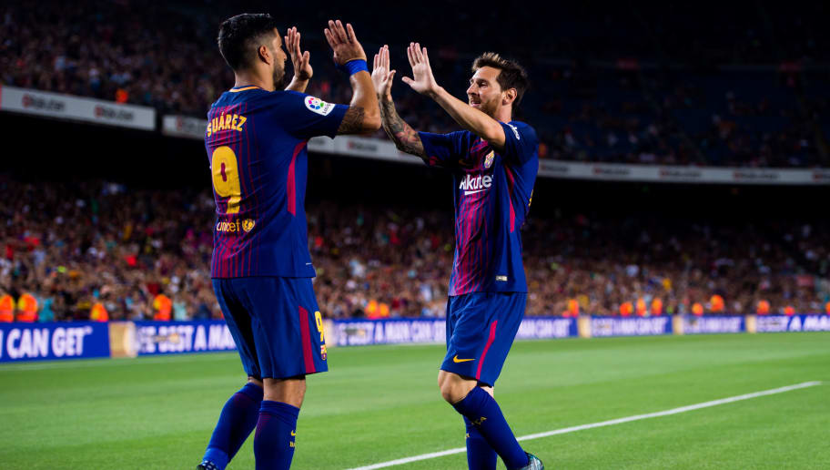 BARCELONA, SPAIN - AUGUST 07:  Luis Suarez (L) of FC Barcelona celebrates with his teammate Lionel Messi after scoring his team's fourth goal during the Joan Gamper Trophy match between FC Barcelona and Chapecoense at Camp Nou stadium on August 7, 2017 in Barcelona, Spain.  (Photo by Alex Caparros/Getty Images)