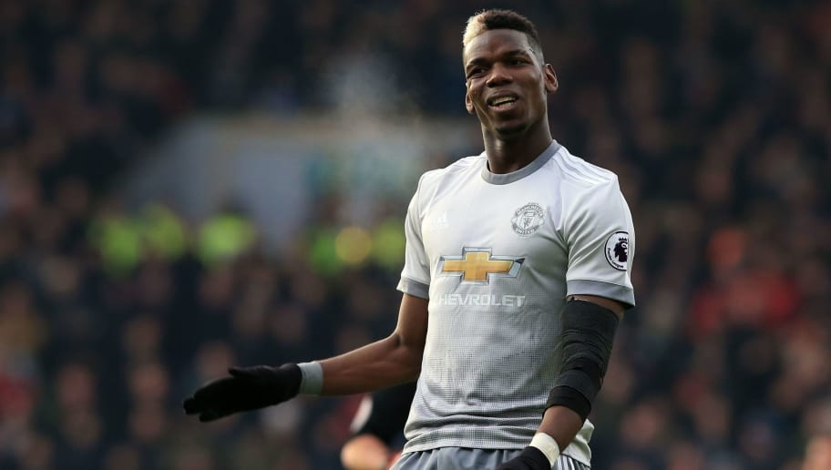 Manchester United's French midfielder Paul Pogba gesures during the English Premier League football match between Burnley and Manchester United at Turf Moor in Burnley, north west England on January 20, 2018. / AFP PHOTO / Lindsey PARNABY / RESTRICTED TO EDITORIAL USE. No use with unauthorized audio, video, data, fixture lists, club/league logos or 'live' services. Online in-match use limited to 75 images, no video emulation. No use in betting, games or single club/league/player publications.  /         (Photo credit should read LINDSEY PARNABY/AFP/Getty Images)