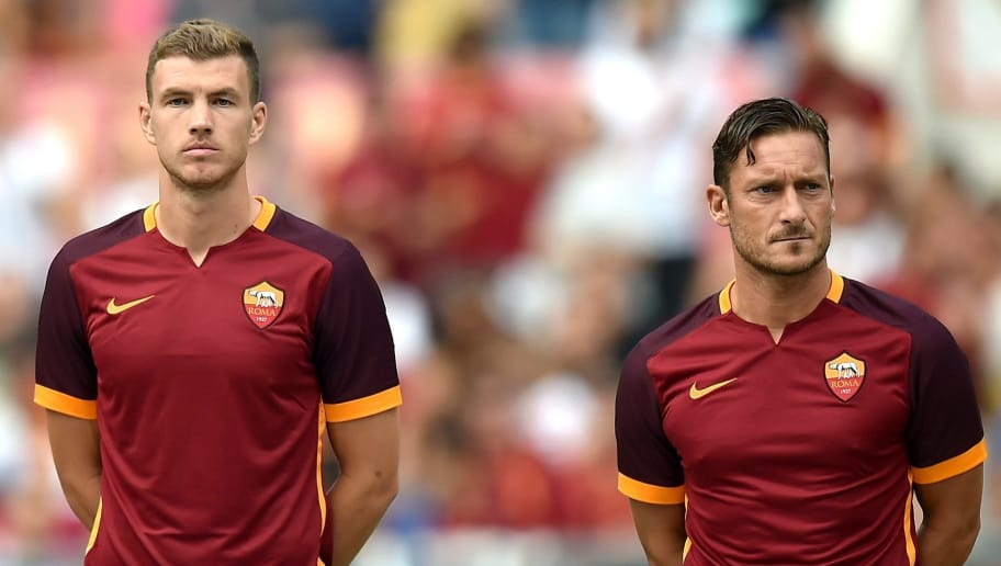 AS Roma's Bosnian forward Edin Dzeko (L) and Italian forward Francesco Totti pose before a friendly football match between Roma and Sevilla on August 14, 2015 at the Olympic Stadium in Rome. AFP PHOTO / ALBERTO PIZZOLI        (Photo credit should read ALBERTO PIZZOLI/AFP/Getty Images)