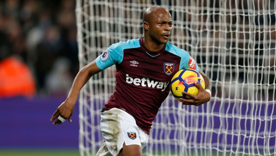 West Ham United's French-born Ghanaian midfielder Andre Ayew collects the ball as he celebrates after scoring their second goal during the English Premier League football match between West Ham United and Newcastle United at The London Stadium, in east London on December 23, 2017. / AFP PHOTO / Ian KINGTON / RESTRICTED TO EDITORIAL USE. No use with unauthorized audio, video, data, fixture lists, club/league logos or 'live' services. Online in-match use limited to 75 images, no video emulation. No use in betting, games or single club/league/player publications.  /         (Photo credit should read IAN KINGTON/AFP/Getty Images)