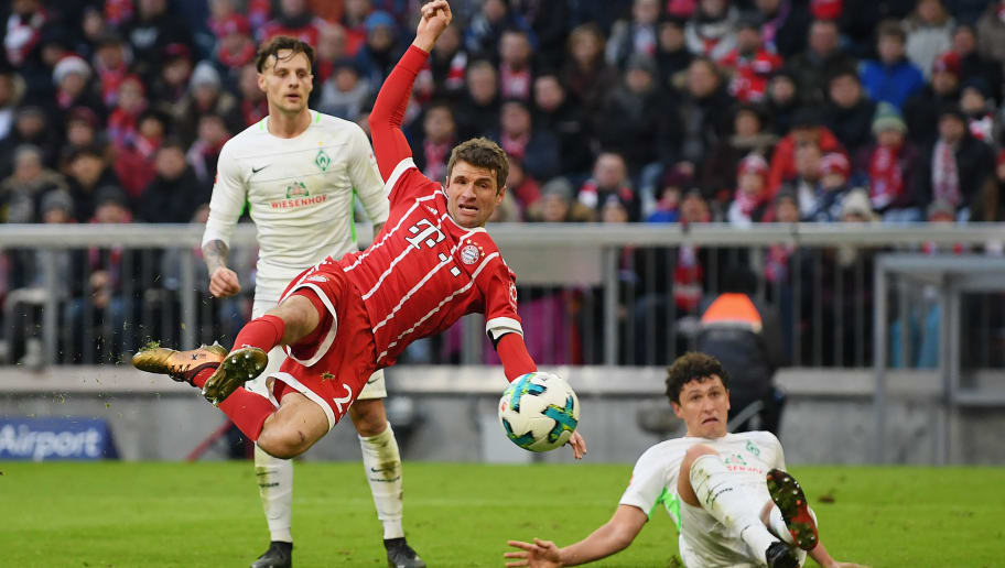 MUNICH, GERMANY - JANUARY 21: Thomas Mueller of FC Bayern Muenchen  scores his team's first goal during the Bundesliga match between FC Bayern Muenchen and SV Werder Bremen at Allianz Arena on January 21, 2018 in Munich, Germany. (Photo by Matthias Hangst/Bongarts/Getty Images)