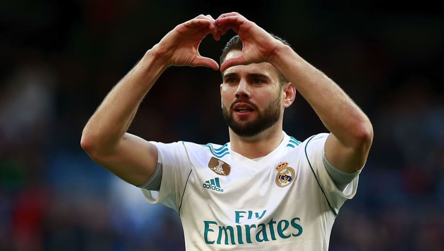 MADRID, SPAIN - JANUARY 21: Nacho Fernandez of Real Madrid CF celebrates scoring their opening goal during the La Liga match between Real Madrid CF and Deportivo La Coruna at Estadio Santiago Bernabeu on January 21, 2018 in Madrid, Spain. (Photo by Gonzalo Arroyo Moreno/Getty Images)