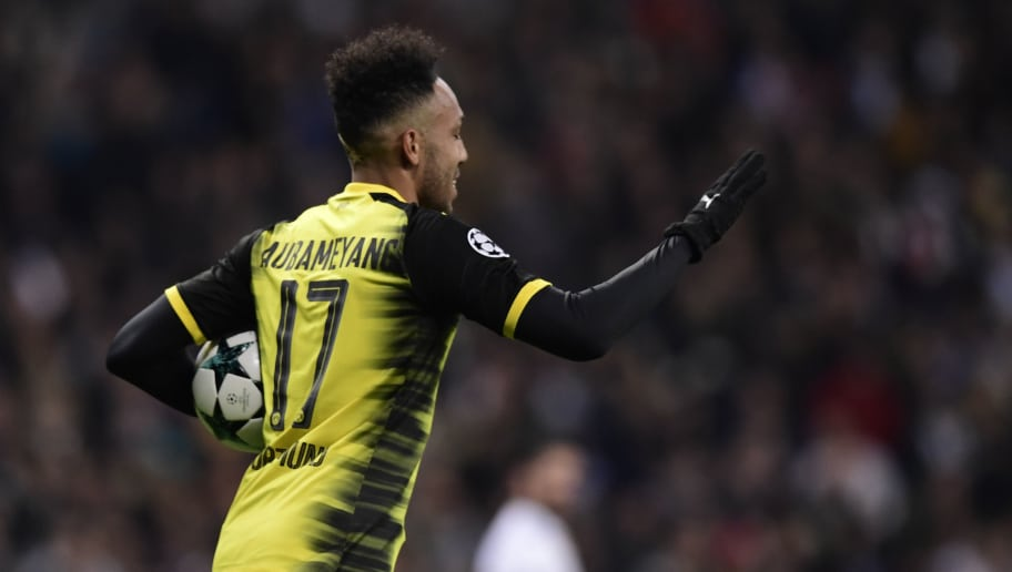 Dortmund's Gabonese forward Pierre-Emerick Aubameyang celebrates a goal during the UEFA Champions League group H football match Real Madrid CF vs Borussia Dortmund at the Santiago Bernabeu stadium in Madrid on December 6, 2017. / AFP PHOTO / JAVIER SORIANO        (Photo credit should read JAVIER SORIANO/AFP/Getty Images)
