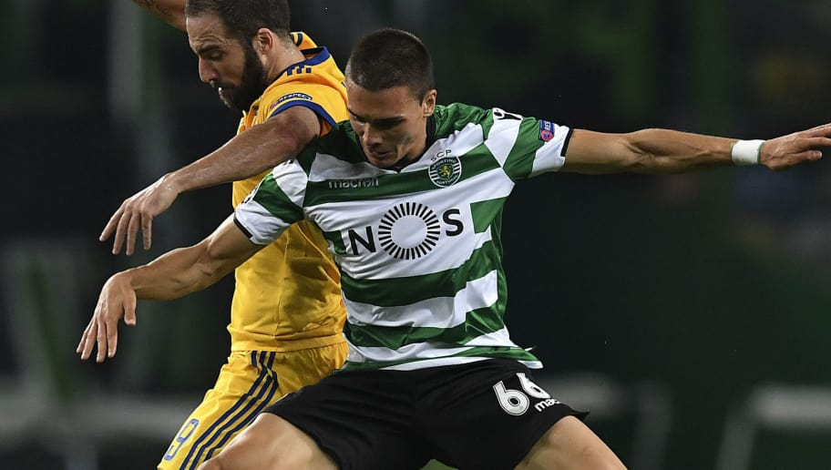 Juventus' Argentinian forward Gonzalo Higuain (L) vies with Sporting's Portuguese midfielder Joao Palhinha during the UEFA Champions League football match Sporting CP vs Juventus FC at the Jose Alvalade stadium in Lisbon on October 31, 2017. / AFP PHOTO / FRANCISCO LEONG        (Photo credit should read FRANCISCO LEONG/AFP/Getty Images)