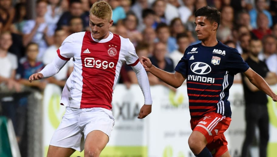 Ajax defender Matthijs de Ligt (L) outruns Lyon's French midfielder Houssem Aouar during a friendly football match between Olympique Lyonnais and Ajax Amsterdam on July 18, 2017 at the Pierre Rajon stadium in Bourgoin-Jallieu.  / AFP PHOTO / JEAN-PHILIPPE KSIAZEK        (Photo credit should read JEAN-PHILIPPE KSIAZEK/AFP/Getty Images)