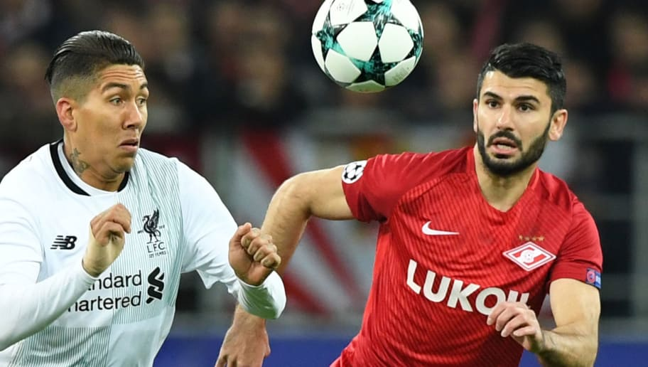 Liverpool's forward from Brazil Roberto Firmino (L) and Spartak Moscow's defender from Germany Serdar Tasci vie for the ball during the UEFA Champions League Group E football match between FC Spartak Moscow and Liverpool FC at the Otkrytie Arena stadium in Moscow on September 26, 2017. / AFP PHOTO / Yuri KADOBNOV        (Photo credit should read YURI KADOBNOV/AFP/Getty Images)