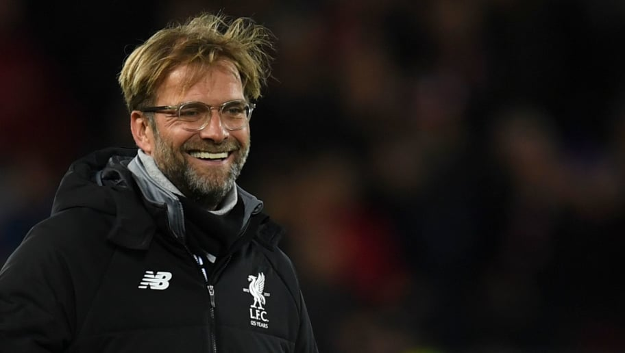 Liverpool's German manager Jurgen Klopp smiles on the pitch at the end of the UEFA Champions League Group E football match between Liverpool and Spartak Moscow at Anfield in Liverpool, north-west England on December 6, 2017. / AFP PHOTO / Paul ELLIS        (Photo credit should read PAUL ELLIS/AFP/Getty Images)
