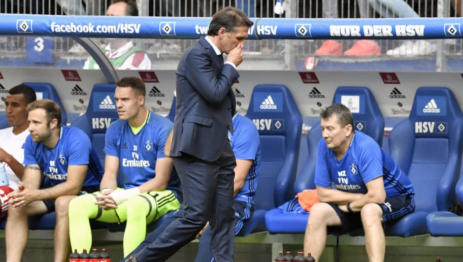 Hamburg's head coach Bruno Labbadia reacts during the German first division Bundesliga football match between Hamburg SV and FC Bayern Munich in Hamburg, northern Germany, on September 24, 2016. / AFP PHOTO / John MACDOUGALL / RESTRICTIONS: DURING MATCH TIME: DFL RULES TO LIMIT THE ONLINE USAGE TO 15 PICTURES PER MATCH AND FORBID IMAGE SEQUENCES TO SIMULATE VIDEO. == RESTRICTED TO EDITORIAL USE == FOR FURTHER QUERIES PLEASE CONTACT DFL DIRECTLY AT + 49 69 650050  / The erroneous mention[s] appearing in the metadata of this photo by John MACDOUGALL has been modified in AFP systems in the following manner: [during the German first division Bundesliga football match between Hamburg SV and FC Bayern Munich in Hamburg, northern Germany, on September 24, 2016.] instead of [during the German first division Bundesliga football match between Eintracht Frankfurt and Hertha Berlin in Frankfurt, western Germany, on September 24, 2016.]. Please immediately remove the erroneous mention[s] from all your online services and delete it (them) from your servers. If you have been authorized by AFP to distribute it (them) to third parties, please ensure that the same actions are carried out by them. Failure to promptly comply with these instructions will entail liability on your part for any continued or post notification usage. Therefore we thank you very much for all your attention and prompt action. We are sorry for the inconvenience this notification may cause and remain at your disposal for any further information you may require.        (Photo credit should read JOHN MACDOUGALL/AFP/Getty Images)
