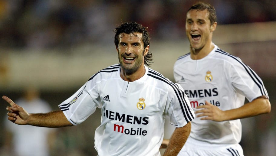 Real Madrid's Portuguese Luis Figo (L) celebrates after scoring their first goal during their Spanish Super Cup first leg match between Mallorca and Real Madrid at the Son Moix stadium of Palma de Mallorca, 24 August, 2003. AFP PHOTO/ Javier SORIANO.  (Photo credit should read JAVIER SORIANO/AFP/Getty Images)