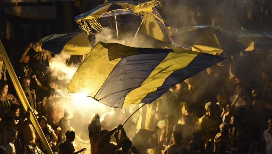 CORDOBA, ARGENTINA - DECEMBER 15:  Fans of Rosario Central wave flags and light flares during a final match between River Plate and Rosario Central as part of Copa Argentina 2016 at Mario Alberto Kempes Stadium on December 15, 2016 in Cordoba, Argentina. (Photo by Amilcar Orfali/LatinContent/Getty Images)