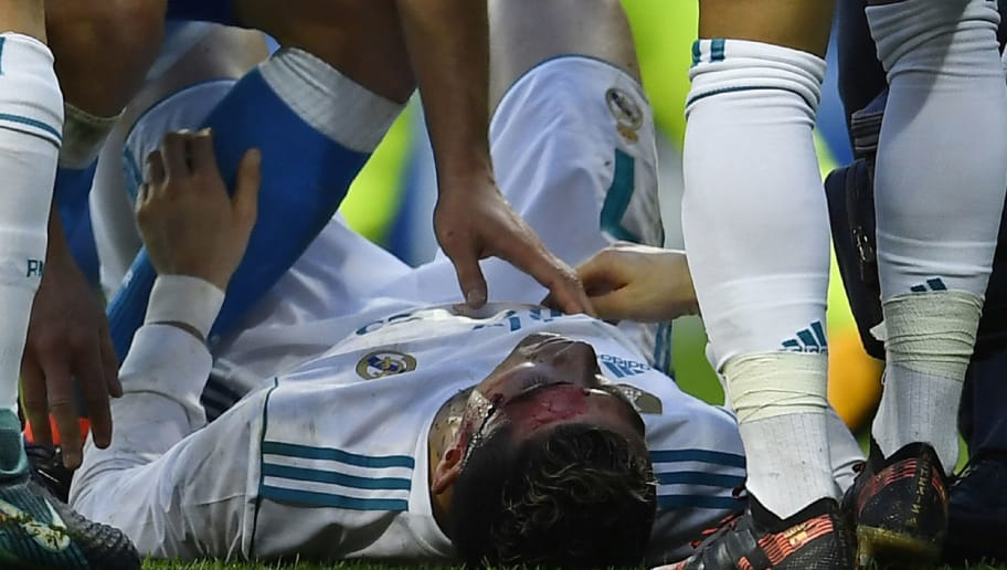 Real Madrid's Portuguese forward Cristiano Ronaldo (down) lies on the field after sustaining an injury during the Spanish league football match between Real Madrid CF and RC Deportivo de la Coruna at the Santiago Bernabeu stadium in Madrid on January 21, 2018. / AFP PHOTO / OSCAR DEL POZO        (Photo credit should read OSCAR DEL POZO/AFP/Getty Images)