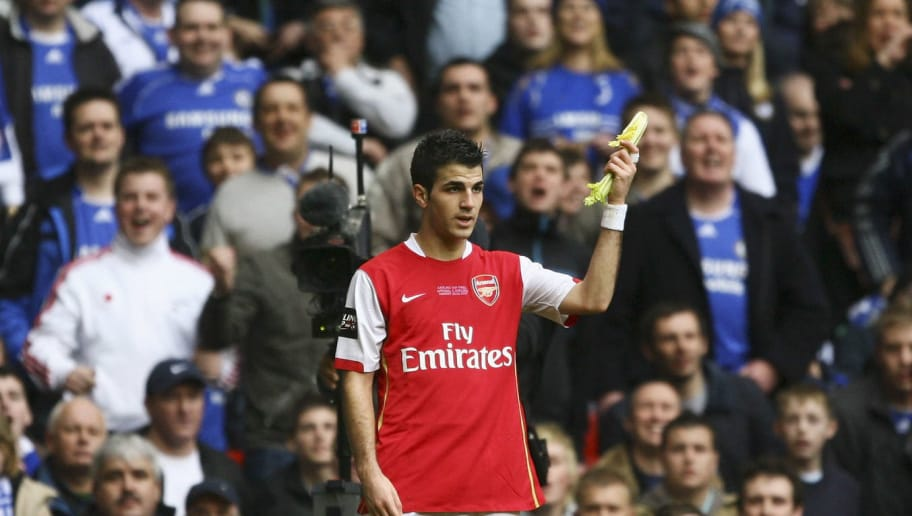 CARDIFF, UNITED KINGDOM - FEBRUARY 25:  Cesc Fabregas of Arsenal holds up a piece of celery thrown by Chelsea fans during the Carling Cup Final match between Chelsea and Arsenal at the Millennium Stadium on February 25, 2007 in Cardiff, Wales. (Photo by Alex Livesey/Getty Images)