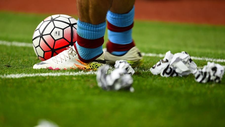 BIRMINGHAM, ENGLAND - APRIL 23: screwed up protest signes are thrown on the pitch during the Barclays Premier League match between Aston Villa and Southampton at Villa Park on April 23, 2016 in Birmingham, United Kingdom.  (Photo by Laurence Griffiths/Getty Images)