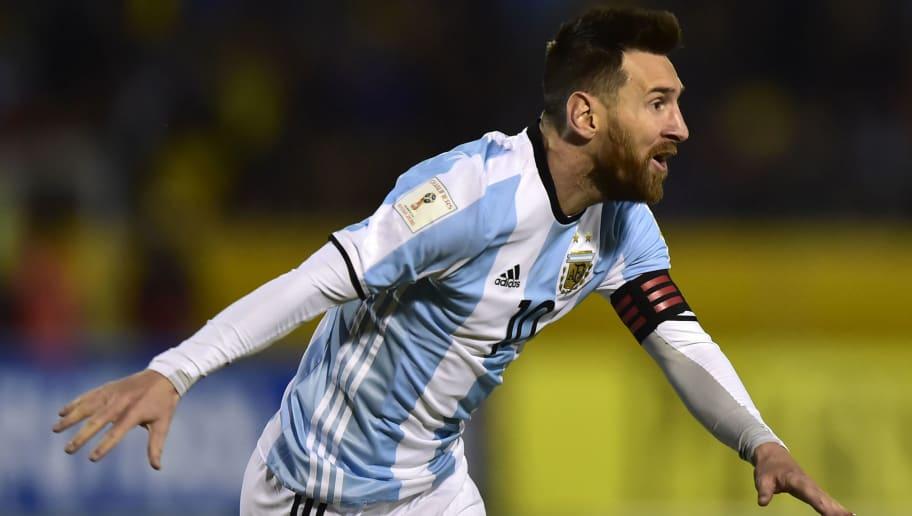 Argentina's Lionel Messi celebrates after scoring his third goal against Ecuador during their 2018 World Cup qualifier football match in Quito, on October 10, 2017. / AFP PHOTO / Rodrigo BUENDIA        (Photo credit should read RODRIGO BUENDIA/AFP/Getty Images)