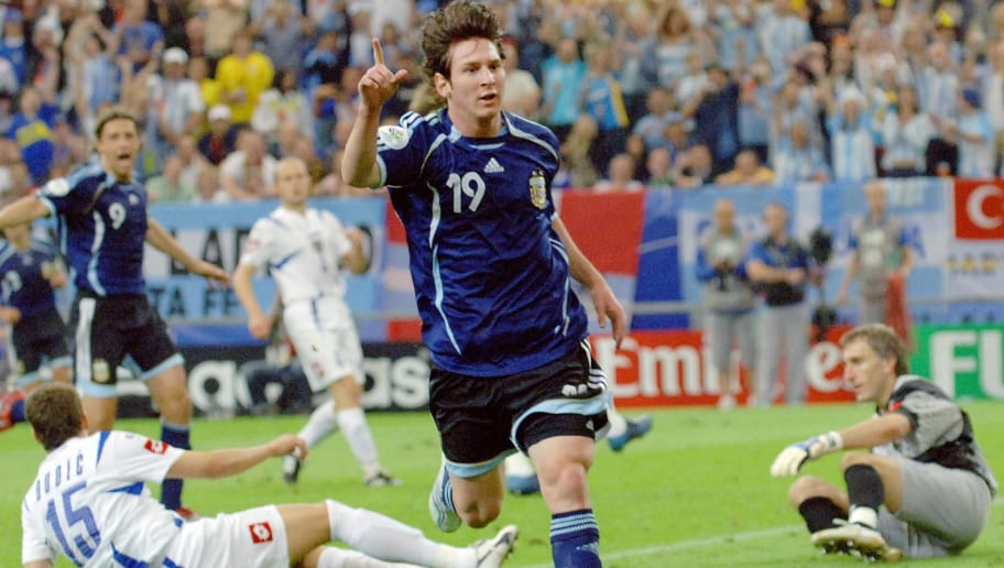 Gelsenkirchen, GERMANY:  Argentinian forward Lionel Messi celebrates after scoring as Serbia and Montenegro's goalkeeper Dragoslav Jevric (R) and Serbia and Montenegro's defender Milan Dudic (15) react during the FIFA World Cup 2006 group C World Cup football match Argentina vs Serbia-Montenegro, 16 June 2006 at Gelsenkirchen stadium. Argentina won 6-0. AFP PHOTO JUNG YEON-JE  (Photo credit should read JUNG YEON-JE/AFP/Getty Images)