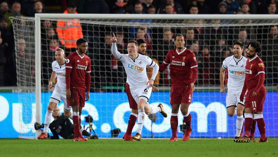 SWANSEA, WALES - JANUARY 22:  Swansea goalscorer Alfie Mawson celebrates the opening goal during the Premier League match between Swansea City and Liverpool at Liberty Stadium on January 22, 2018 in Swansea, Wales.  (Photo by Stu Forster/Getty Images)