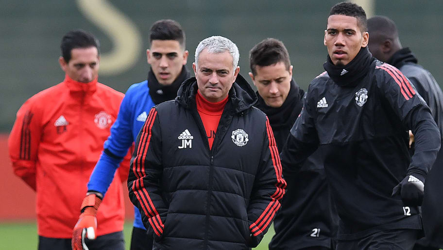 Manchester United's Portuguese goalkeeper Joel Castro Pereira (2L), Manchester United's Portuguese manager Jose Mourinho (C) Manchester United's Spanish midfielder Ander Herrera (2R) and Manchester United's English defender Chris Smalling attend a team training session at the club's training complex near Carrington, west of Manchester in north west England on November 21, 2017, on the eve of their UEFA Champions League Group A football match against Basel. / AFP PHOTO / Paul ELLIS        (Photo credit should read PAUL ELLIS/AFP/Getty Images)