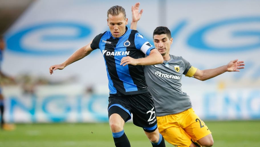 Club's Ruud Vormer (L) vies with AEK's Petros Mantalos during the UEFA Europa League playoff round football match between Club Brugge KSV and AEK Athens FC in Brugge on August 17, 2017. / AFP PHOTO / Belga / BRUNO FAHY / Belgium OUT        (Photo credit should read BRUNO FAHY/AFP/Getty Images)