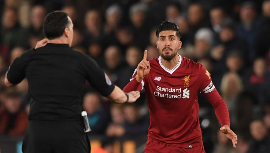SWANSEA, WALES - JANUARY 22: Liverpool player Emre Can reacts to  Referee Neil Swarbrick during the Premier League match between Swansea City and Liverpool at Liberty Stadium on January 22, 2018 in Swansea, Wales.  (Photo by Stu Forster/Getty Images)