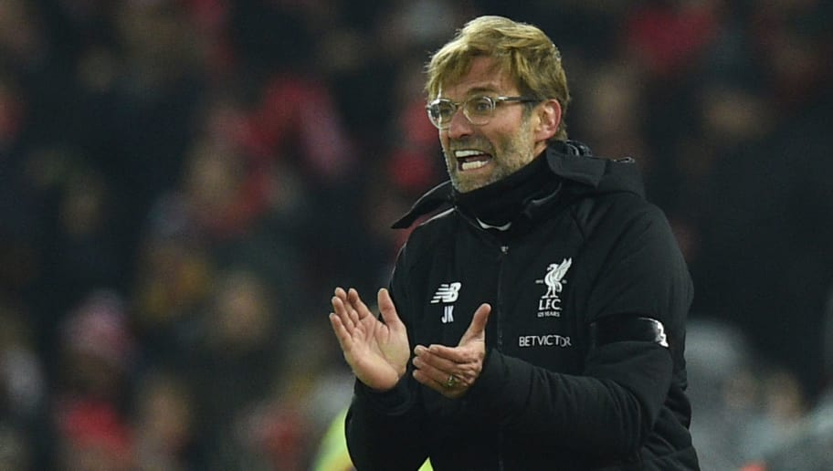 Liverpool's German manager Jurgen Klopp applauds on the touchline during the English Premier League football match between Liverpool and Manchester City at Anfield in Liverpool, north west England on January 14, 2018. / AFP PHOTO / Oli SCARFF / RESTRICTED TO EDITORIAL USE. No use with unauthorized audio, video, data, fixture lists, club/league logos or 'live' services. Online in-match use limited to 75 images, no video emulation. No use in betting, games or single club/league/player publications.  /         (Photo credit should read OLI SCARFF/AFP/Getty Images)