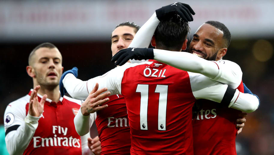 LONDON, ENGLAND - JANUARY 20:  Alexandre Lacazette of Arsenal celebrates scoring his side's fourth goal with Mesut Ozil and team mates during the Premier League match between Arsenal and Crystal Palace at Emirates Stadium on January 20, 2018 in London, England.  (Photo by Clive Mason/Getty Images)