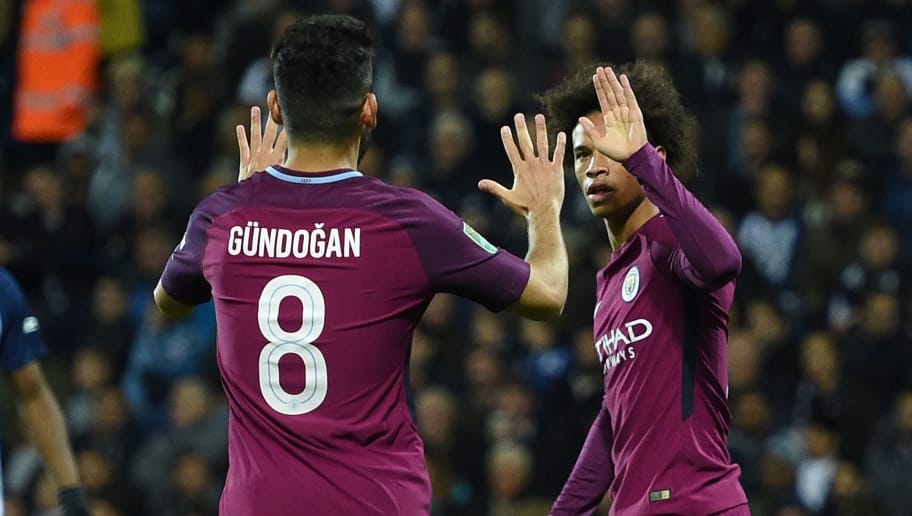 Manchester City's German midfielder Leroy Sane (R) celebrates with Manchester City's German midfielder Ilkay Gundogan after scoring the opening goal of the English League Cup third round football match between West Bromwich Albion and Manchester City at The Hawthorns in West Bromwich, central England September 20, 2017. / AFP PHOTO / Oli SCARFF / RESTRICTED TO EDITORIAL USE. No use with unauthorized audio, video, data, fixture lists, club/league logos or 'live' services. Online in-match use limited to 75 images, no video emulation. No use in betting, games or single club/league/player publications.  /         (Photo credit should read OLI SCARFF/AFP/Getty Images)