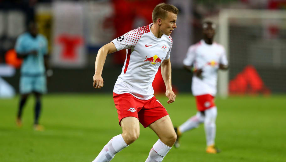 LEIPZIG, GERMANY - OCTOBER 17:  Lukas Klostermann of Leipzig runs with the ball during the UEFA Champions League group G match between RB Leipzig and FC Porto at Red Bull Arena on October 17, 2017 in Leipzig, Germany.  (Photo by Martin Rose/Bongarts/Getty Images)